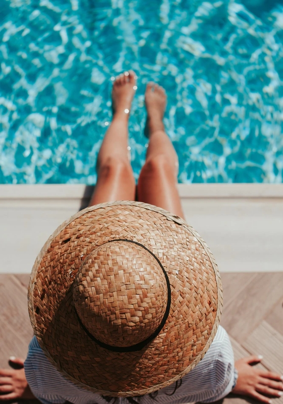 Person Relaxed Next to a Safe Swimming Pool