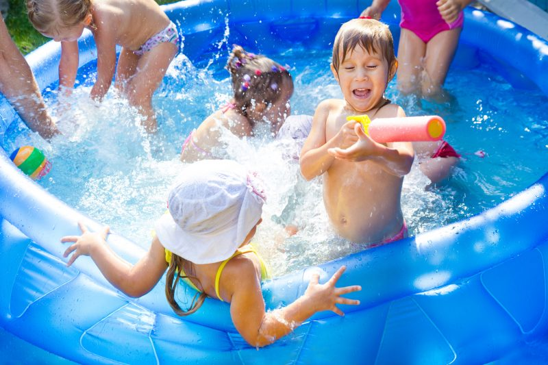 kids playing in a portable swimming pool