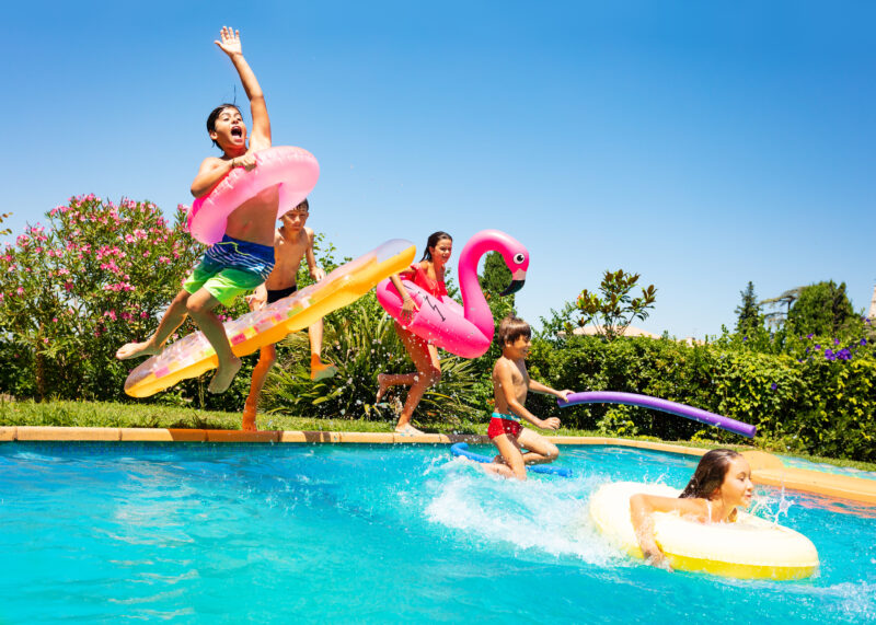 Family playing in swimming pool